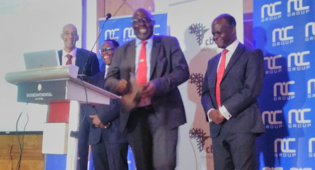 NIC Group PLC shareholders overwhelmingly approved the company's plan to merge with Commercial Bank of Africa Limited.