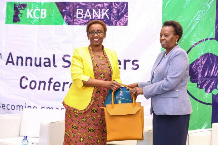 KCB Group Head of Corporate and Regulatory Affairs, Judith Sidi Odhiambo (L), presents a copy of the 2019 KCB Sustainability Report and token of appreciation to Kenya Breweries Limited, Managing Director - Jane Karuku, during the 5th KCB Annual Supplier conference