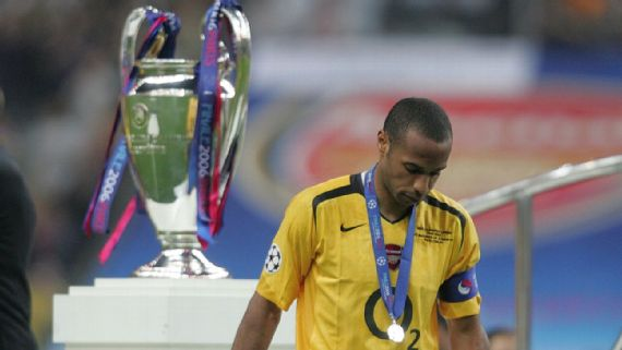 Thierry Henry walks past the UCL Trophy in the 2006 Final