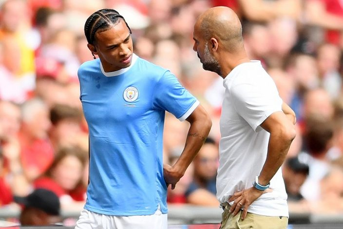 Leroy Sane and Pep Guardiola