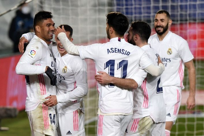 : Real Madrid beat Granada 2-0 to move level with league leaders Atletico Madrid