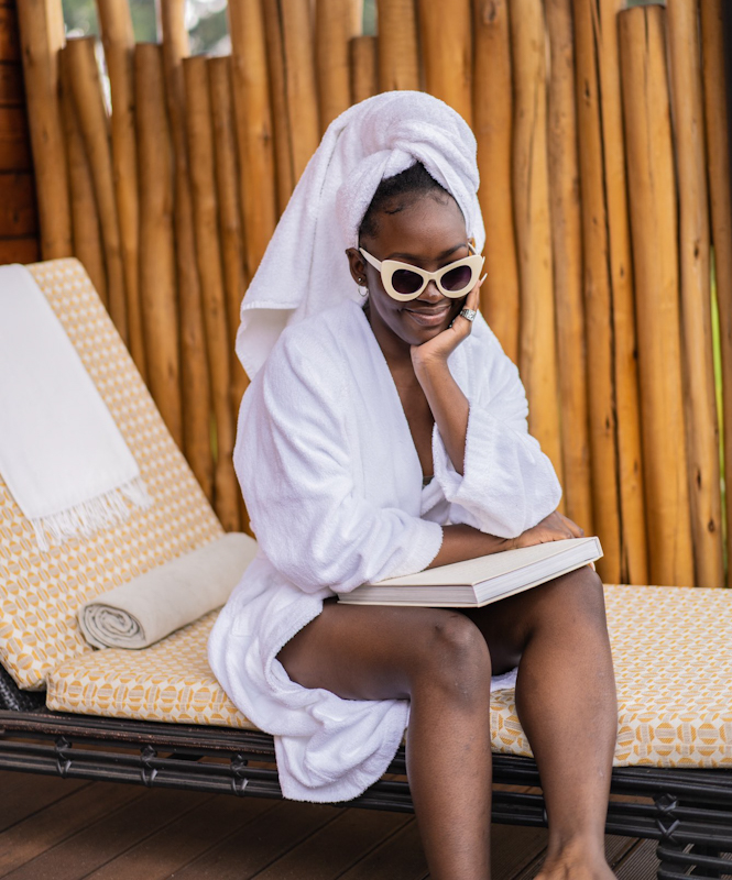 """Taking through her Twitter, the 19-year-old Kenyan shared two pictures a captioned """"family vacay""""."""