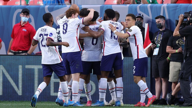 USA beat Mexico 3-2 in extra time to lift the CONCACAF trophy.